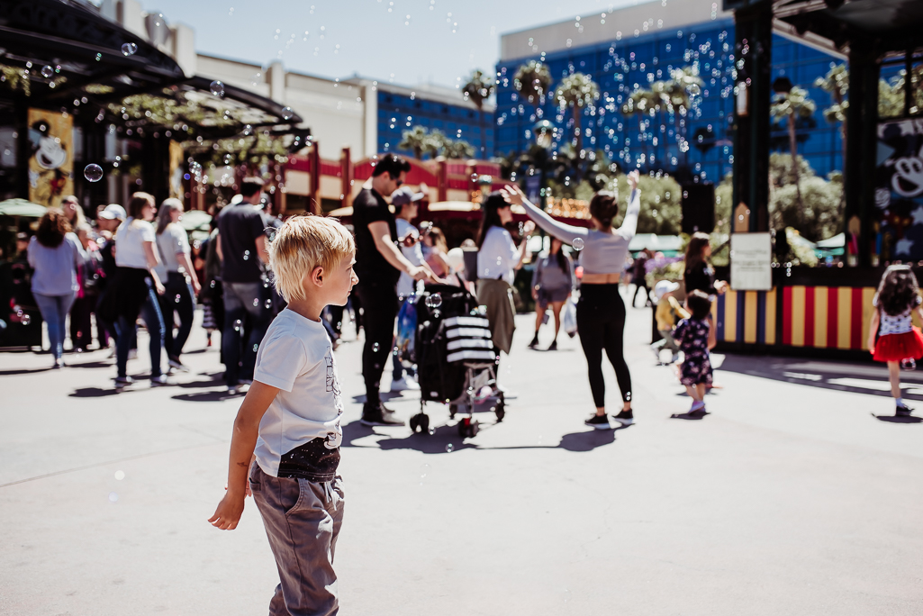 boy playing in bubbles downtown disney anaheim {san diego lifestyle child couples family military homecoming photographer}
